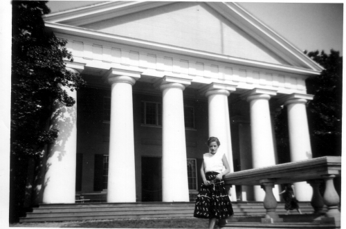 ARLENE CLENDENEN STANDING IN FRONT OF A WASHINGTON DC BUILDING.