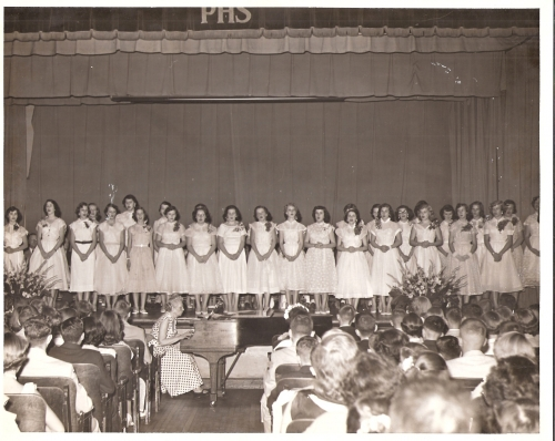 PUTNAM JR. HIGH GIRLS' CHORUS MEMBERS SING AT 9TH GRADE GRADUATION - MAY 1954.  MOVITA STEVENS CONTRIBUTED THESE PHOTOS